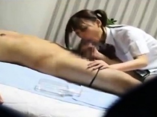 Massage from Asian mollycoddle includes blowjob for her client
